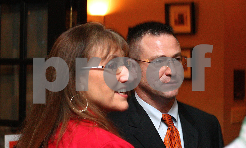 Kyle Bursaw – kbursaw@shawmedia.com<br /> <br /> Sean Smith, a candidate for DeKalb County State's Attorney, looks up from talking with some of his supporters to see the latest results, showing him trailing incumbent Clay Campbell by just over 2000 votes with 75 of 90 precincts reporting at that time at Nat's on Maple in Sycamore, Ill. on Tuesday, March 20, 2012.