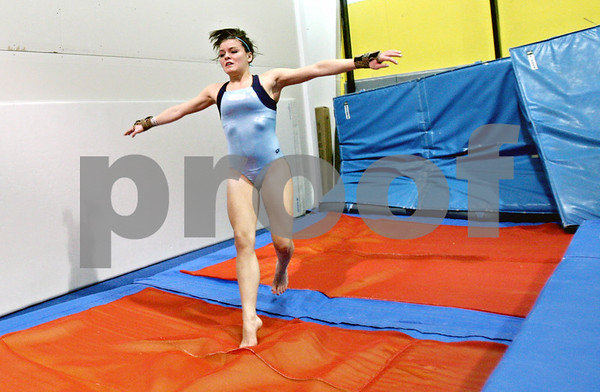 Rob Winner – rwinner@shawmedia.com<br /> <br /> DeKalb gymnast Alyssa Lopez lands after a vault during practice at Energym in Sycamore, Ill. on Monday, Jan. 2, 2012.