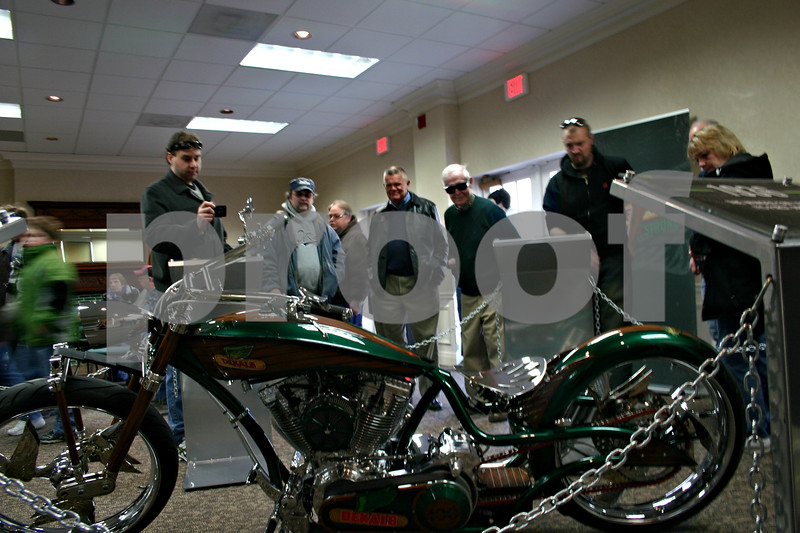 Jeff Engelhardt – jengelhardt@shawmedia.com<br /> A custom motorcycle celebrating the 100th anniversary of the DeKalb brand was the center of attention during an agricultural heritage display Sunday at the Ellwood House Museum.