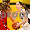 Kyle Bursaw – kbursaw@shawmedia.com<br /> <br /> Sycamore's Lauren Miller looks for somewhere to pass as Yorkville's Alicyn Hester guards during the second quarter of their game in Sycamore, Ill. on Tuesday, Jan. 24, 2012.