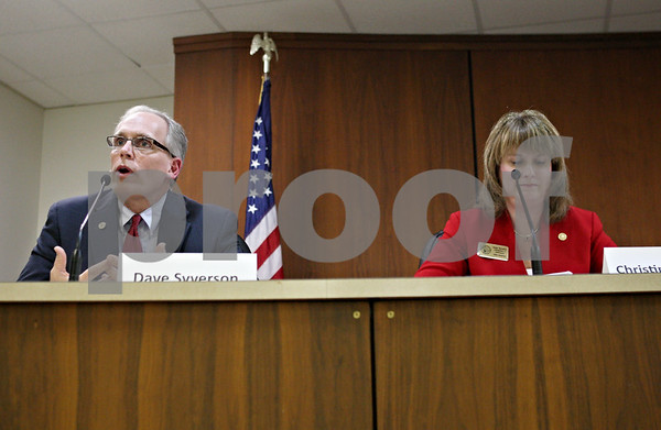 Rob Winner – rwinner@shawmedia.com<br /> <br /> Dave Syverson (left) fields a question while Christine Johnson listens as the League of Women Voters of DeKalb County hosted a candidate night on Thursday at DeKalb City Hall. State senators Syverson and Johnson are running for the Republican nod for the 35th District seat.