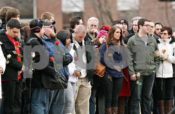 Rob Winner – rwinner@shawmedia.com<br /> <br /> Northern Illinois students that were inside of Cole Hall during the shooting on Feb. 14, 2008, gather before a memorial service on Tuesday afternoon in DeKalb.<br /> <br /> DeKalb, Ill.<br /> Tuesday, Feb. 14, 2012