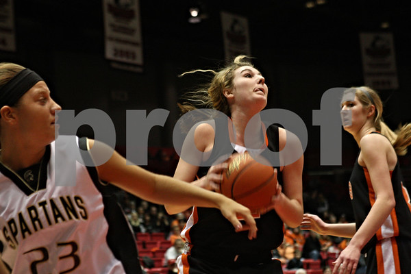 Rob Winner – rwinner@shawmedia.com<br /> <br /> After controlling a rebound during the second quarter, DeKalb's Emily Bemis looks to shoot. DeKalb defeated Sycamore, 39-37, on Friday night at the Convocation Center in DeKalb.