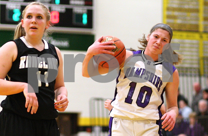 Kyle Bursaw – kbursaw@shawmedia.com<br /> <br /> Hampshire's Jennifer Dumoulin reacts to a call turning the ball over to Kaneland during the first quarter at Sycamore High School on Monday, Feb. 20, 2012. Kaneland defeated Hampshire 40-31.