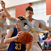 Rob Winner – rwinner@daily-chronicle.com<br /> <br /> Somonauk's Katie Peluse (33) looks to pass while being pressured by Hiawatha defenders Dani Clark (left) and Randi Maynard (right) in the first quarter during the Little Ten Conference Tournament in Earlville on Tuesday night.