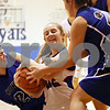 Rob Winner – rwinner@shawmedia.com<br /> <br /> Newark's Taylor Rehberg (left to right), Hinckley-Big Rock's Lauren Paver, and Newark's Kelsey Patrick struggle over a loose ball under the Royals' basket during the first quarter in Hinckley.