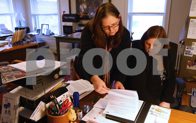 Kyle Bursaw – kbursaw@shawmedia.com<br /> <br /> Dawn Littlefield (left) goes over some meeting notes with Jackie DiNatale in the Kishwaukee United Way office where they both work on Tuesday, Feb. 7, 2012. The Kishwaukee United Way is a member of both the DeKalb and Sycamore chambers of commerce.