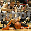Rob Winner – rwinner@shawmedia.com<br /> <br /> After a scramble for a loose ball during the third quarter, DeKalb's Rachel Torres (bottom) passes the ball as Sycamore's Bailey Gilbert (top) tries to get a hand on it. DeKalb defeated Sycamore, 39-37, on Friday night at the Convocation Center in DeKalb.