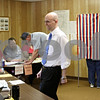 Rob Winner – rwinner@shawmedia.com<br /> <br /> DeKalb County Clerk John Acardo visits with election judges at the Cortland Township Building on Tuesday afternoon.