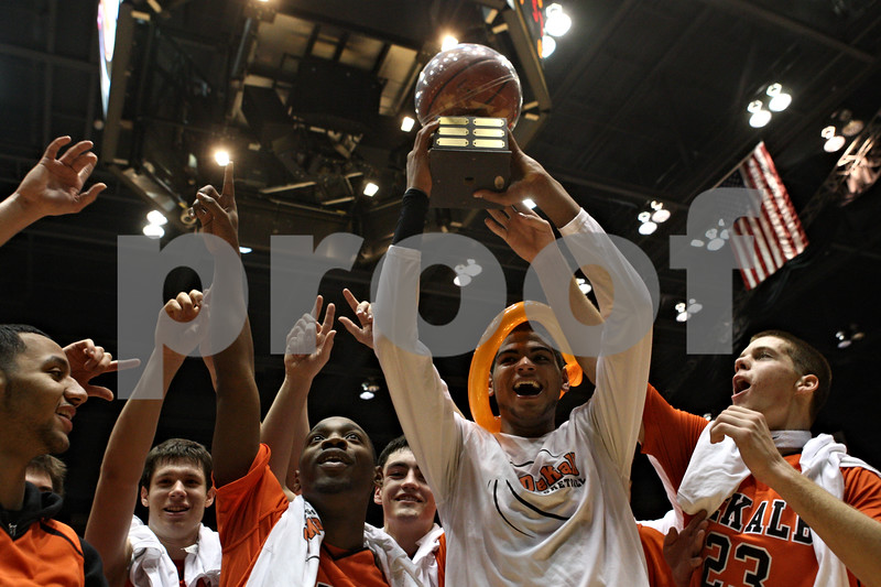 Rob Winner – rwinner@shawmedia.com<br /> <br /> DeKalb celebrates their 57-41 victory over Sycamore at the Convocation Center in DeKalb on Friday night.