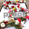 Rob Winner – rwinner@shawmedia.com<br /> <br /> Wreaths lay on a table before the start of Tuesday's memorial service at Northern Illinois University in DeKalb.<br /> <br /> DeKalb, Ill.<br /> Tuesday, Feb. 14, 2012