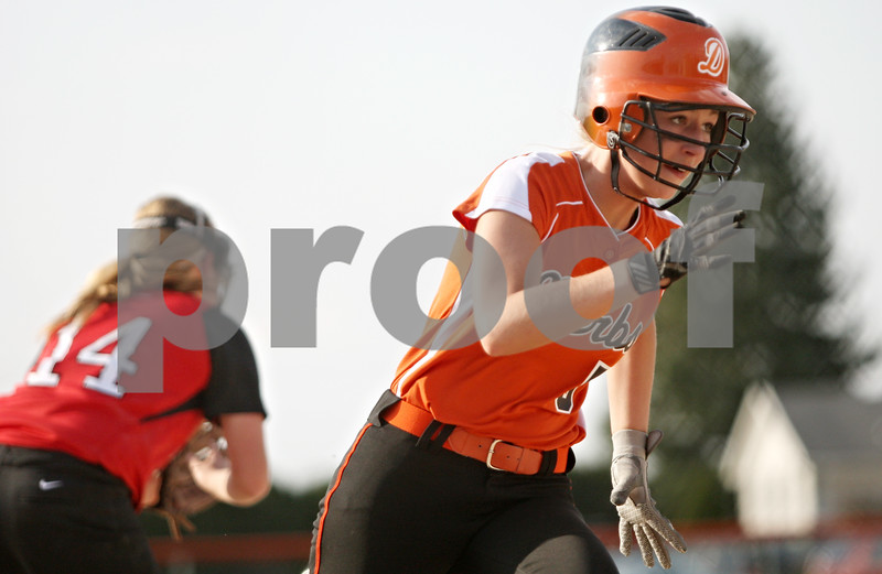 Rob Winner – rwinner@shawmedia.com<br /> <br /> DeKalb base runner Tori Voorhis rounds third base before scoring on a triple by Katie Kowalski (not pictured) during the bottom of the second inning in DeKalb on Wednesday.
