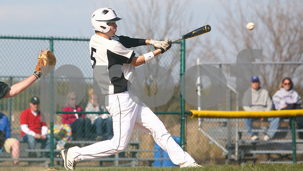 Kyle Bursaw – kbursaw@shawmedia.com<br /> <br /> Kaneland's Tyler Heinle connects with a Rochelle pitch to send in teammate John Hopkins (not pictured), putting Kaneland up 1-0 in the first inning at Kaneland High School in Maple Park on Thursday, April 12, 2012.