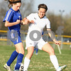 Kyle Bursaw – kbursaw@shawmedia.com<br /> <br /> Sycamore's Katherine Kohler (14) and<br /> Burlington Central's Ellen Jayne (7) battle for possession during the second half of their match at Sycamore High School on Tuesday, March 20, 2012.