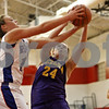 Rob Winner – rwinner@shawmedia.com<br /> <br /> Hinckley-Big Rock's Katie Hollis (12) and Serena's Jeri Brennan (24) compete for a rebound under the Lady Royals' basket in the first quarter during their Little Ten Conference tournament game in Earlville on Thursday night.