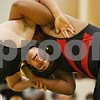 Rob Winner – rwinner@shawmedia.com<br /> <br /> Sycamore's Martin Malone (left) competes against Rock  Island's Trae Nichols during their 285-pound match in a Class 2A Sycamore Team Sectional semifinal on Tuesday, Feb. 21, 2012.