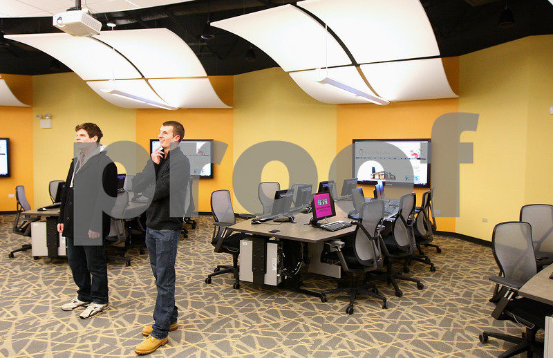 Kyle Bursaw – kbursaw@shawmedia.com<br /> <br /> Northern Illinois students J.P. Harvey (left) and Alex Jandick, both 20, admire the Cole Hall's new collaboratory classroom. The two do not have a class in the room, but decided to check it out on the first day it was open, Tuesday, Jan. 17, 2012.
