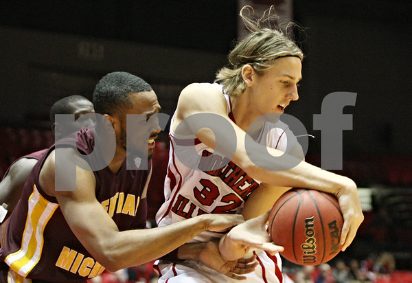 Rob Winner – rwinner@shawmedia.com<br /> <br /> Northern Illinois' Aksel Bolin (32) controls an offensive rebound ahead of Central Michigan's Trey Zeigler (right) during the first half in DeKalb on Saturday afternoon.