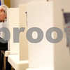 Kyle Bursaw – kbursaw@shawmedia.com<br /> <br /> Peter Dennis of Sycamore casts a ballot in the primary on the first day of early voting in the Legislative Center in Sycamore, Ill. on Thursday, Feb. 9, 2012. Dennis said he votes in every election, including primaries, and generally on the first day.