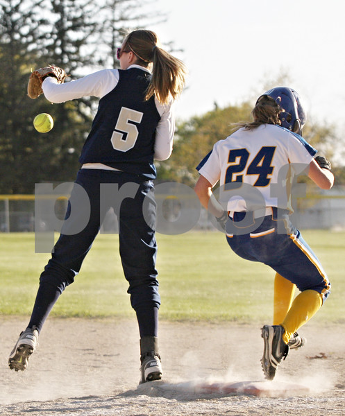 Rob Winner – rwinner@shawmedia.com<br /> <br /> Hiawatha first baseman Alanna Sterling (5) can't control a ball as Somonauk baserunner Ashlee Kawall (24) reaches safely on the error during the top of the seventh inning Wednesday afternoon in Kirkland. Somonauk scored nine runs in the seventh inning to defeat Hiawatha, 12-6.