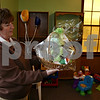 Jeff Engelhardt – jengelhardt@shawmedia.com<br /> Sandra Davis shows an example of the gift basket that will be offered through the Moses' Basket ministry to all people receiving donations. Moses' Basket is DEKalb Wesleyan's newest outreach program for parents with infants.