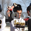 Kyle Bursaw – kbursaw@shawmedia.com<br /> <br /> Sycamore's Mitchell Jordan is greeted at home plate by Matt Godinsky (left) and Alec Kozak (right) after his home run in the first inning against DeKalb at Sycamore Park on Monday, April 9, 2012. Sycamore won 15-5.
