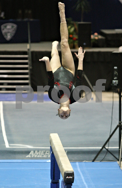 Rob Winner – rwinner@shawmedia.com<br /> <br /> Northern Illinois' Ashley Guerra competes on the balance beam during the 2012 Mid-American Conference Gymnastics Championships at the Convocation Center in DeKalb on Saturday afternoon.