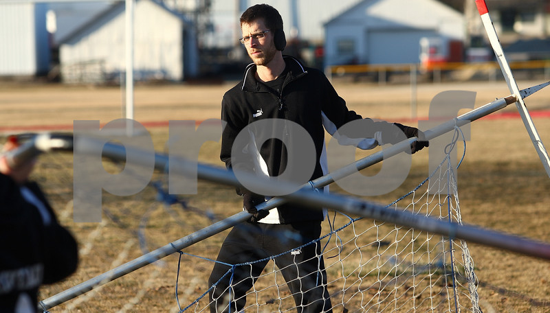 Kyle Bursaw – kbursaw@shawmedia.com<br /> <br /> Indian Creek girls soccer coach Luke Anderson moves a net with the help of one of his players during practice at Indian Creek Middle School on Friday, March 9, 2012. Previously an assistant coach for the team, Anderson will be leading the Timberwolves for the first time as head coach this season.