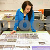 Kyle Bursaw – kbursaw@shawmedia.com<br /> <br /> Genoa-Kingston sophomore Allison Pfeiffer looks at advanced drafting teacher Phil Jerbi's example project design of an Amtrak station in Genoa while waiting her turn to use one of the classroom computers to work on the project on Thursday, March 1, 2012.