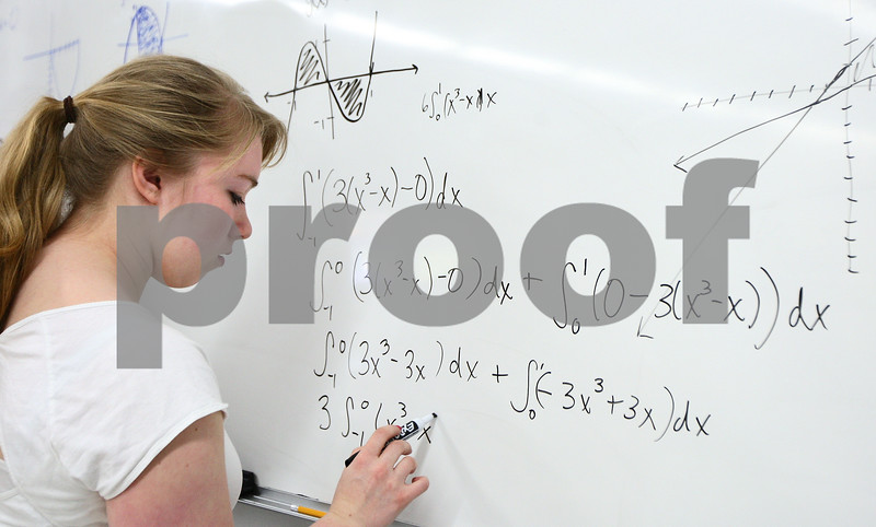 Kyle Bursaw – kbursaw@shawmedia.com<br /> <br /> Amanda Hamrick works on a calculus problem in Ken Mathiesen's AP Calculus AB class at Hiawatha on Friday, April 13, 2012. The class was finishing up the last of the new material before reviewing the upcoming AP test.
