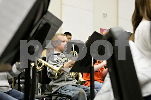 Rob Winner – rwinner@shawmedia.com<br /> <br /> Trumpet player James Cerny pauses for a moment during band practice at Sycamore Middle School on Tuesday.