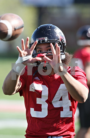 Rob Winner – rwinner@shawmedia.com<br /> <br /> James Spencer during the Northern Illinois football team's first practice of the spring Wednesday, March 28, in DeKalb, Ill.