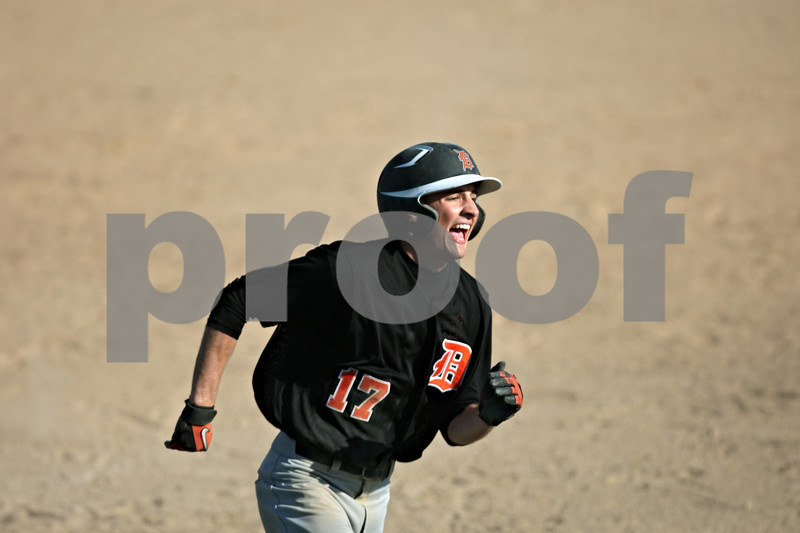 Rob Winner – rwinner@shawmedia.com<br /> <br /> DeKalb baserunner Tyler Gosnell rounds third base before scoring during the top of the third inning Thursday in Sycamore. DeKalb defeated Sycamore, 9-2.
