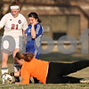 Rob Winner – rwinner@shawmedia.com<br /> <br /> Indian Creek goalkeeper Carole Fleetwood makes a diving save in front of teammate Sara Sanderson (21) and Genoa-Kingston's Nanastasia Haller Wade (12) during the second half in Waterman on Thursday, March 15, 2012. G-K defeated Indian Creek, 2-1.