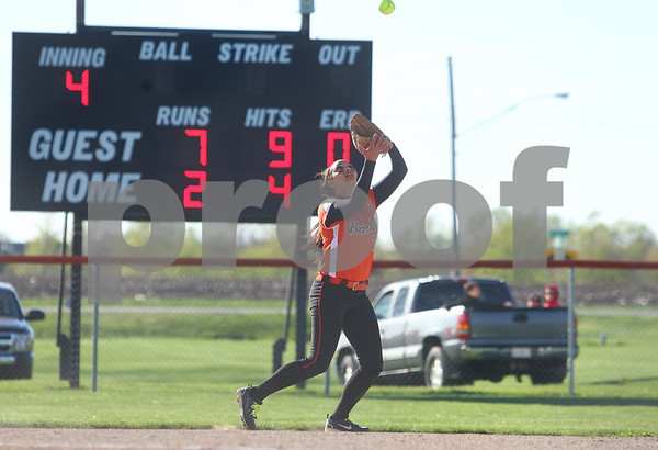 Kyle Bursaw – kbursaw@shawmedia.com<br /> <br /> DeKalb's Jessica Townsend makes a grab in the fourth inning of the game against Kaneland at Huntley Middle School on Thursday, April 5, 2012.