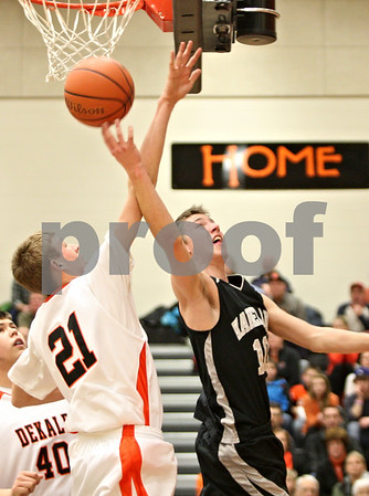 Rob Winner – rwinner@shawmedia.com<br /> <br /> DeKalb's James Robinson (21) fouls Kaneland's Trever Heinle during the second quarter in DeKalb on Friday, Feb. 10, 2012. Kaneland defeated DeKalb, 65-55.
