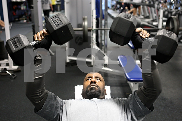 Rob Winner – rwinner@shawmedia.com<br /> <br /> DeKalb resident Hussul Greer works out at the Kishwaukee Family YMCA in DeKalb, Ill., on Monday, Jan. 2, 2012. Greer who played defensive tackle, once weighed over 300 pounds, but after his first child was born he decided to start working out. In two years Greer has lost over 70 pounds and he plans to run a 5k this year.