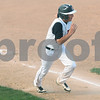 Kyle Bursaw – kbursaw@shawmedia.com<br /> <br /> DeKalb's Patrick Aves runs home to score one of DeKalb's runs in their 6-2 victory over Sycamore at Huntley Middle School on Tuesday, April 10, 2012.