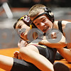 Rob Winner – rwinner@shawmedia.com<br /> <br /> Marko Tupanjac (left), of Deer Path Middle School in Lake Forest, competes with Brendan McGee, of Huntley Middle School in DeKalb, during a 100-pound match at the Illinois Elementary School Association wrestling tournament held at the Convocation Center in DeKalb on Saturday.