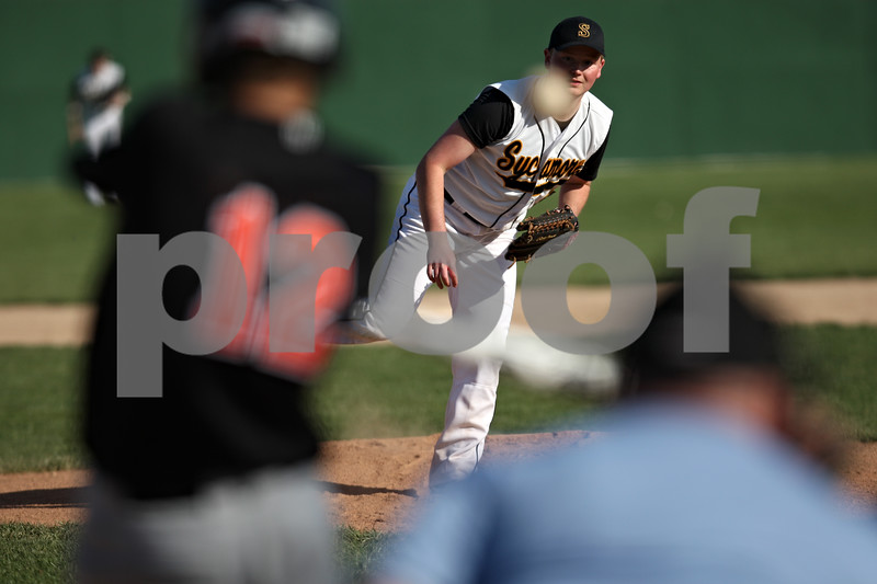Rob Winner – rwinner@shawmedia.com<br /> <br /> DeKalb batter Matt Hoyle (12) makes contact with a pitch from Sycamore's Will Olson during the top of the second inning Thursday in Sycamore. DeKalb defeated Sycamore, 9-2.