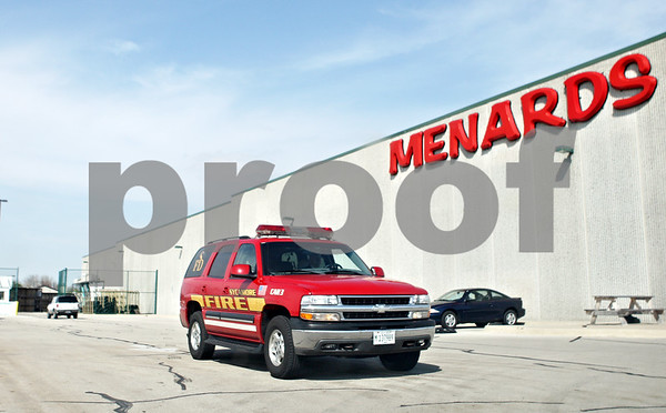 Rob Winner – rwinner@shawmedia.com<br /> <br /> A Sycamore Fire Department vehicle leaves the fenced lot behind Menards in Sycamore on Tuesday afternoon.