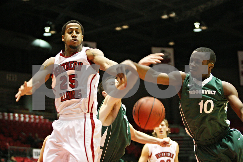 Rob Winner – rwinner@shawmedia.com<br /> <br /> Northern Illinois guard Tony Nixon (25), Roosevelt guard Mark Tometich (3) and Roosevelt guard Tyree York (10) try to control a rebound under the Huskies' basket during the first half in DeKalb, Ill., on Monday, Jan. 2, 2012.