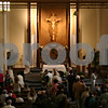 Jeff Engelhardt – jengelhardt@shawmedia.com<br /> Fr. Ken Anderson of St. Mary Parish gives communion during an 8 a.m. Easter Sunday service.