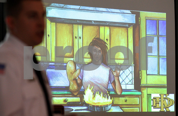 Kyle Bursaw – kbursaw@shawmedia.com<br /> <br /> Lieutenant Luke Howieson, with DeKalb Fire, highlights how to safely extinguish a cooking fire during a presentation at the Convocation Center on Friday, Jan. 20, 2012.