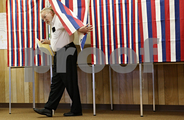 Rob Winner – rwinner@shawmedia.com<br /> <br /> Jim Read exits a voting booth at the Cortland Township Building on Tuesday afternoon.