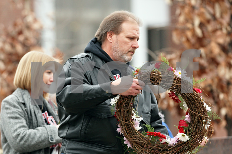 Rob Winner – rwinner@shawmedia.com<br /> <br /> Eric and Mary Kay Mace, parents of Ryanne Mace, take part in the procession to the wreath laying at the memorial on the Northern Illinois campus in DeKalb on Tuesday afternoon.<br /> <br /> DeKalb, Ill.<br /> Tuesday, Feb. 14, 2012