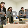 "Rob Winner – rwinner@shawmedia.com<br /> <br /> Carrie Williams (left) and Deborah Fransen pick out a ceramic bowl before having it filled with soup during the 14th Empty Bowls event Friday in DeKalb at Northern Illinois University's Adams Hall. Money raised during the event went to support Hope Haven. ""It's a great cause with good food and I try to come every year,"" said Williams who was attending for her third year."