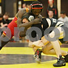 Rob Winner – rwinner@shawmedia.com<br /> <br /> Rock Island's Ignace Hakizimana (left) competes against Sycamore's Kyle Akins during the 120-pound match in a Class 2A Sycamore Team Sectional semifinal on Tuesday, Feb. 21, 2012.