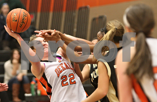 Rob Winner – rwinner@shawmedia.com<br /> <br /> DeKalb's Emily Bemis (22) tries to control an offensive rebound during the fourth quarter in DeKalb on Thursday, Feb. 9, 2012.