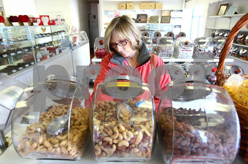 Kyle Bursaw – kbursaw@shawmedia.com<br /> <br /> Ellen Anderson picks out some candy at the Confectionary in DeKalb to send to her daughter, a former DeKalb resident now living in Baltimore, on Thursday, Feb. 9, 2012.